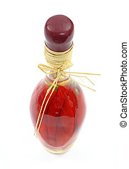 Red peppers in glass bottle