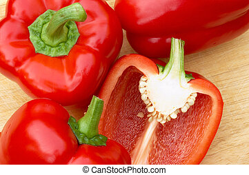 Red Peppers on a Chopping Board
