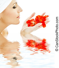 red petals in water #3 - lovely woman with red flower petals...