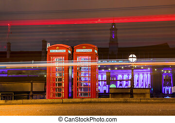 Red PHONE BOOTHS at night in London, England, UK