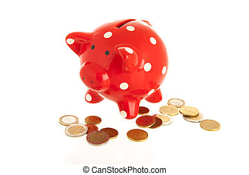 Red piggy bank with coins