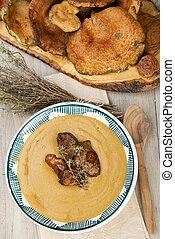 Red pine mushroom or saffron milk cap cream soup flavored with thym
