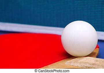 Ping Pong - Red Ping Pong Paddle on table with net and ball...
