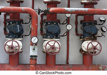 Red pipes with valves and manometers