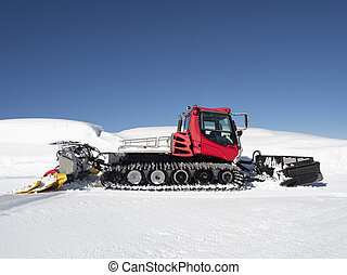 Red piste caterpillar for snow grooming in ski resorts at ...