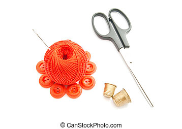 red plastic buttons, thimble, scissors and thread