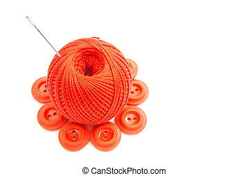 red plastic buttons, thread and needle