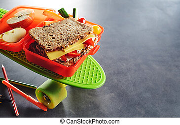 Red plastic kids school lunch box with sandwich