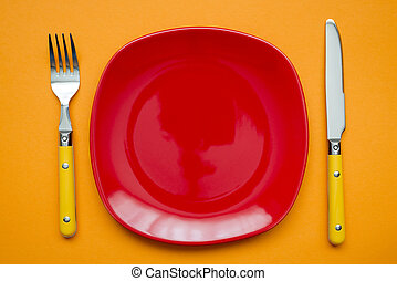 red plate on orange