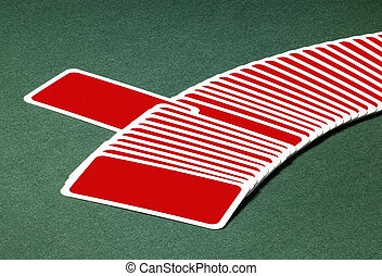 red playing cards - studio photography of spread out playing...