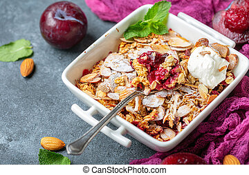 Red plum crumble with crunchy oatmeal and almond.