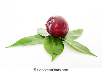 red plum with green leaves isolated on white background
