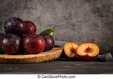 Red plums in a cork plate