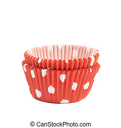 Red polka dot cupcake cups isolated over the white background