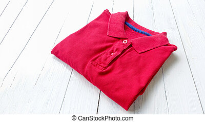 polo shirt - red polo shirt put on white wooden table