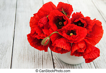 Red poppies in a vase