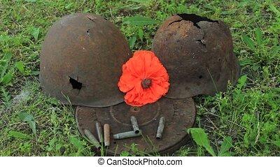 red poppy on the helmet
