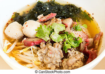 Red pork noodles with flavouring closeup