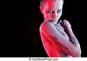 red - Portrait of an artistic woman painted with clay. Shot ...