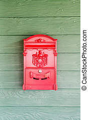 red post box on wall
