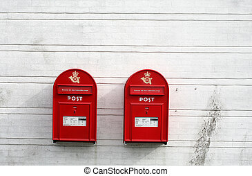 red post boxes - 2 red post boxes and and white wall in...
