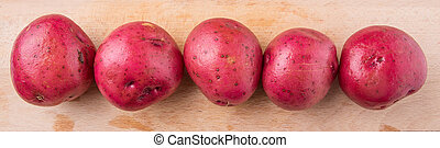 Red Potato - Red potato on wooden surface