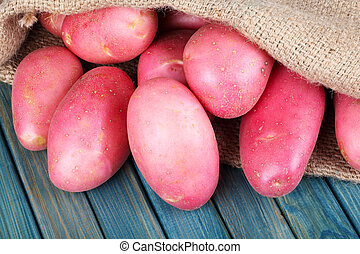 red potatoes in burlap sack