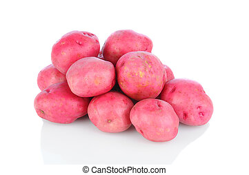 A pile of red potatoes on a white background with reflection, Horizontal format.