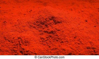 Red Powder Rotating - Pile of red powder turning slowly