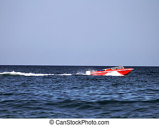 Red power boat
