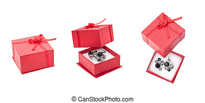 Red present box and earrings