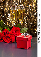 Red present box Champagne and roses