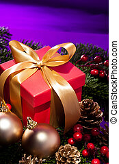 Red present box in a purple Christmas setting