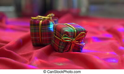 Red present box on silk background with lights