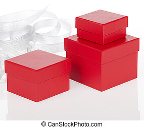 Red present box on white