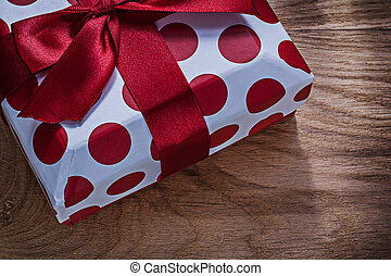 Red present box on wooden board close up view celebrations conce