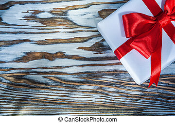 Red present box on wooden surface