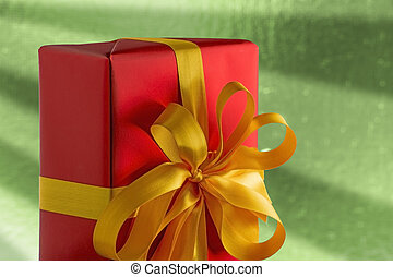 Red present on green background