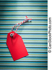 Red price tag on striped tablecloth