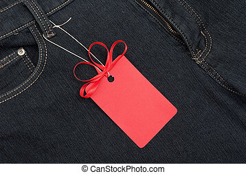 Red price tag over jeans