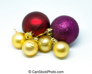 Red, purple and golden Christmas balls on a white background