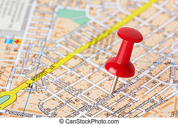 Red pushpin on a map - Red pushpin on a city map