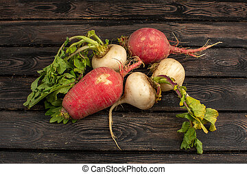 red radish on a wooden background