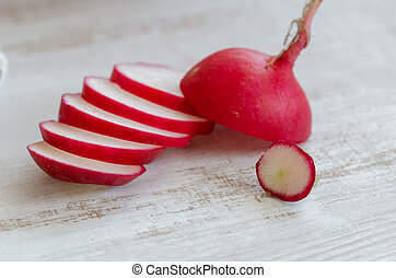 Red radish on white wooden table.