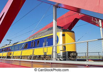 red railroad bridge - train passing the new red railroad...