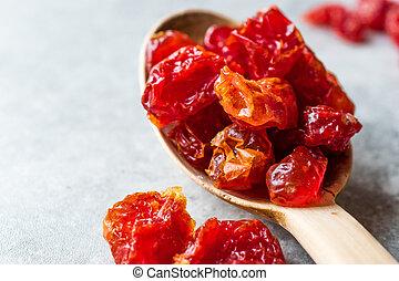 Red Raisins in Wooden Spoon.