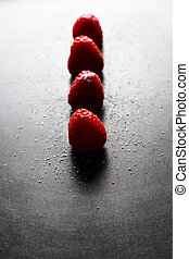 Red raspberries in a row.