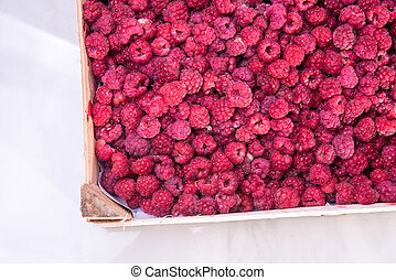Red raspberries in the box