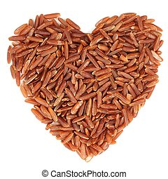 Red raw rice in heart shape, isolated
