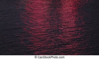 Red reflection on water
